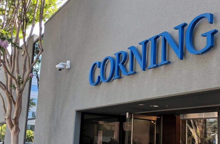 What does Corning offer for Apple to have invested 450 million dollars in this historic glass and crystal manufacturer